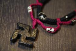 swastika charm necklace